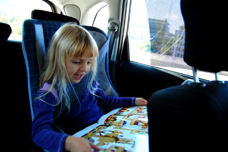 Girl Reading in Car
