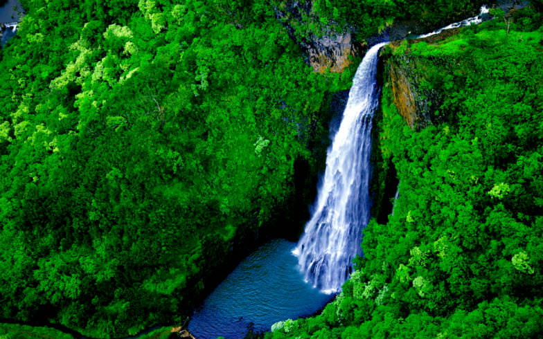 Manawaiopuna Falls, one of the many amazing attractions in Kauai.