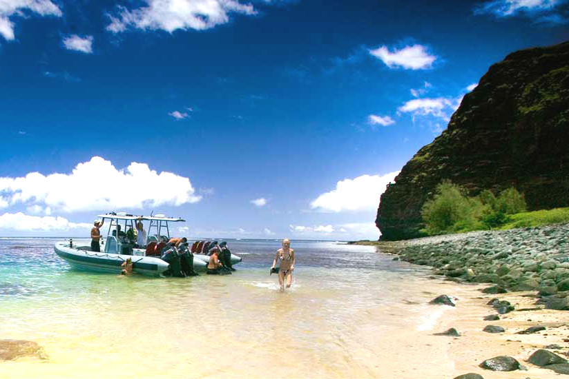 Go on a snorkeling adventure in the Napali Coast in Kauai.