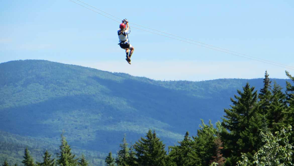 Zip line with Bretton Woods Canopy Tour at Omni Mount Washington Resort.