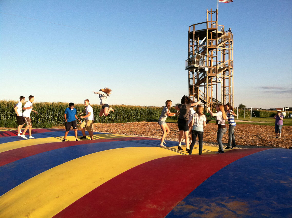 Kids at Richardson Farm in front of the world's biggest corn maze.