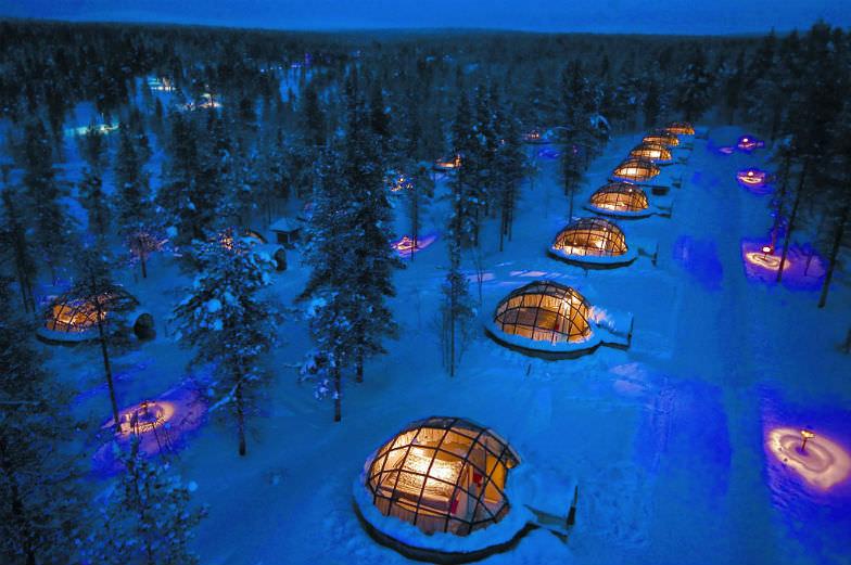 Sleep under the Northern Lights at the Kakslauttanen Arctic Resort.