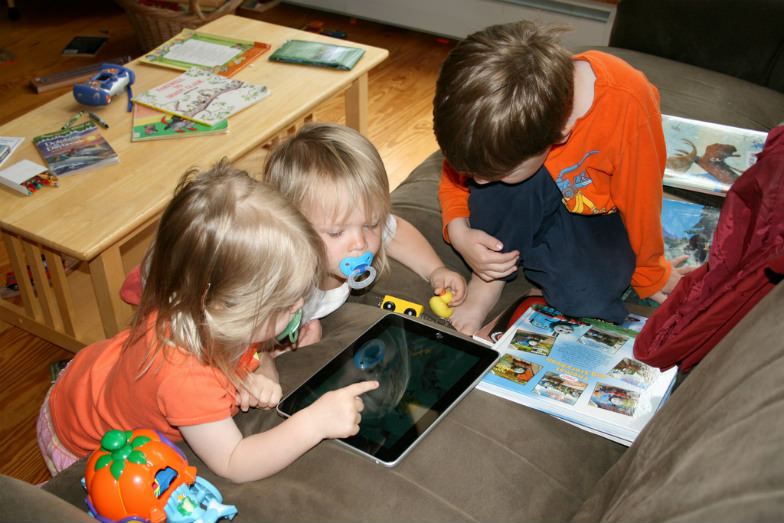 Kids playing games on the iPad