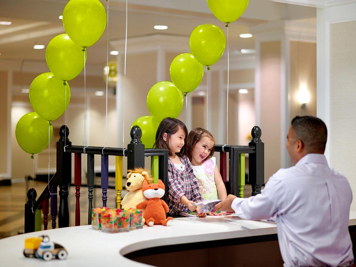 Young guests enjoying a special kids' check-in at The Chelsea Hotel.