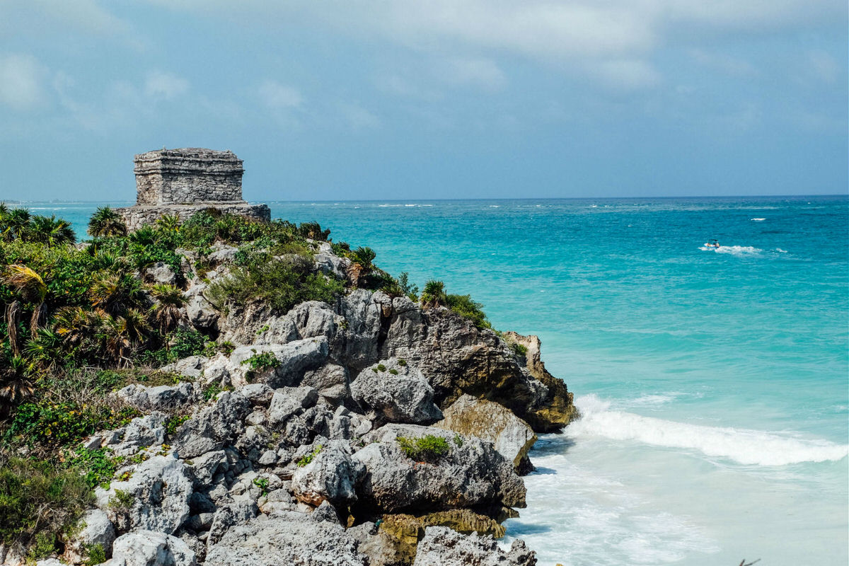 Plan a day trip to Tulum and explore Mayan ruins.