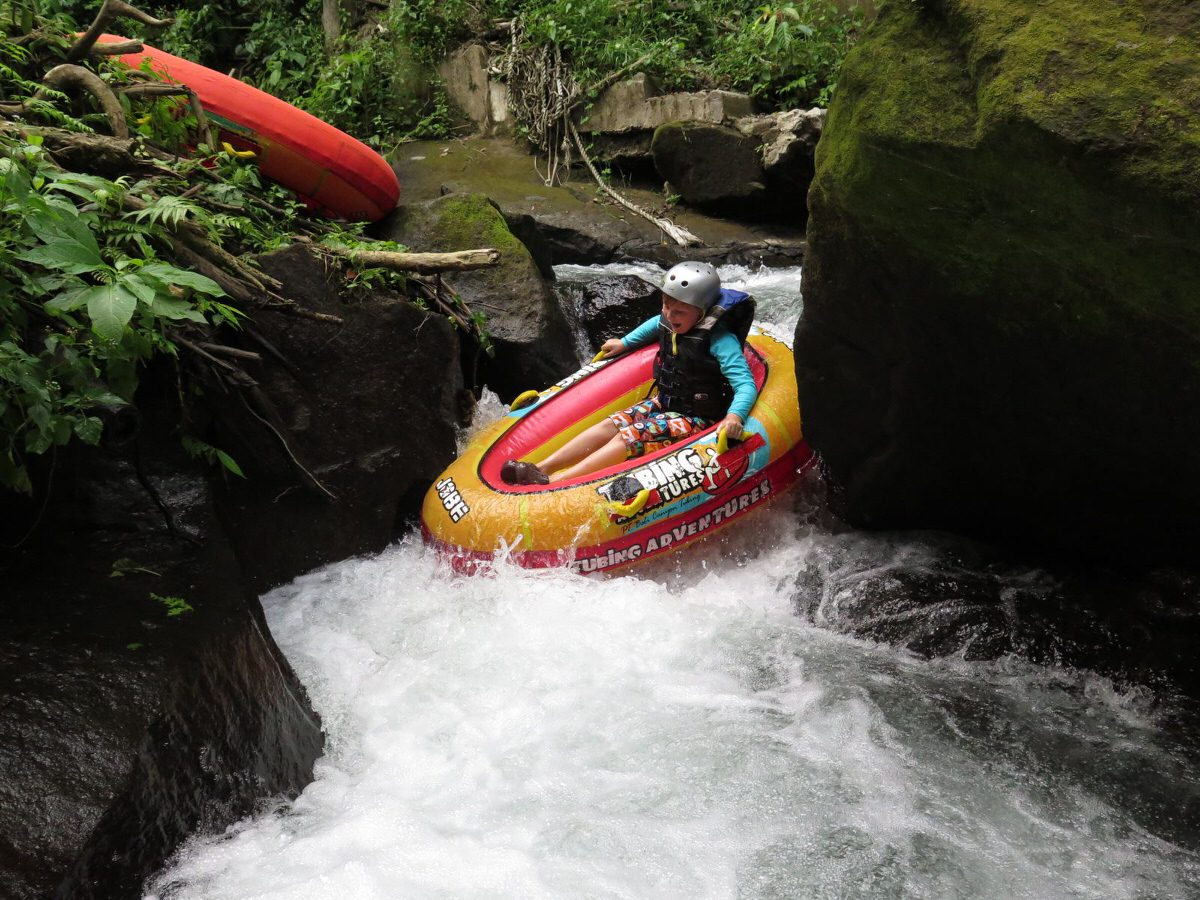 Riding the current into a secret canyon is one of the best water activities for kids in Bali.
