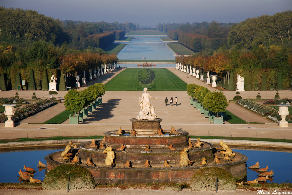 Explore the palace grounds of Versailles in France.