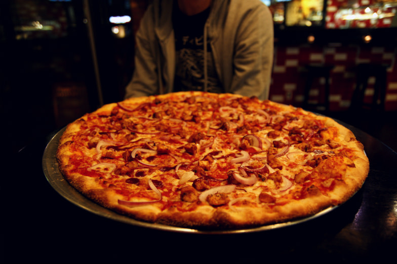 You cannot have the complete NYC experience without its traditional thin crust pizza.