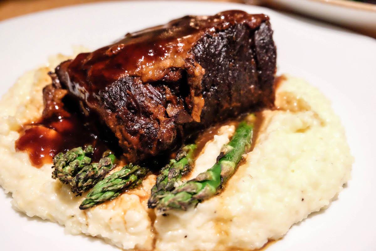 Short rib with garlic herb grits and roasted asparagus at Eats