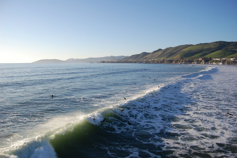 Surfers and waves in Pismo Beach