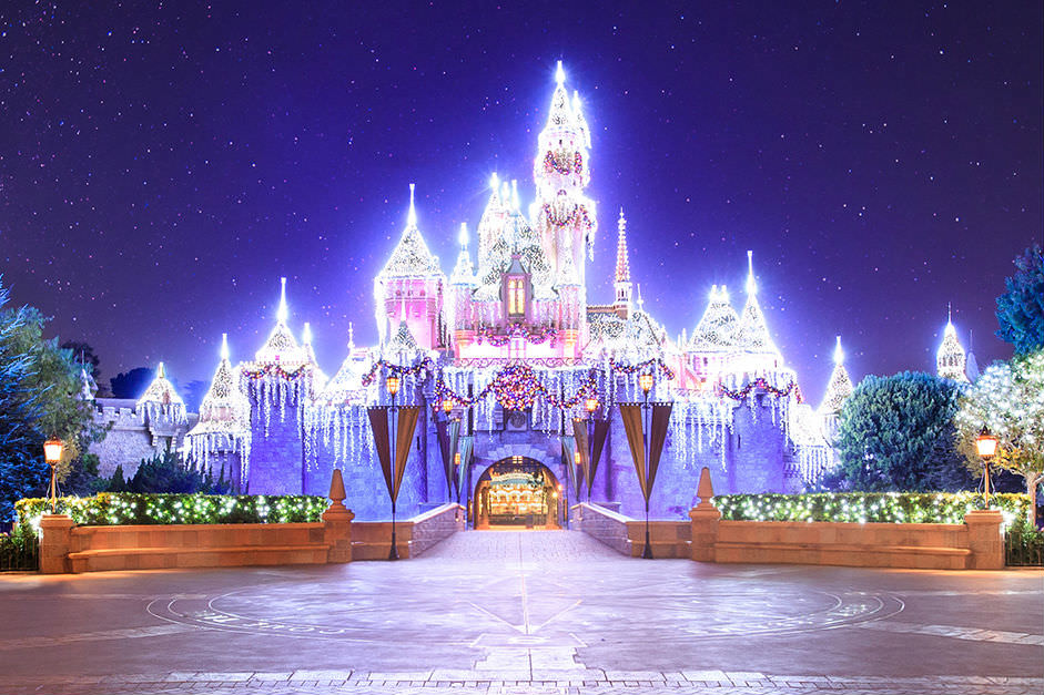 The Sleeping Beauty Castle glistens during the holiday season.