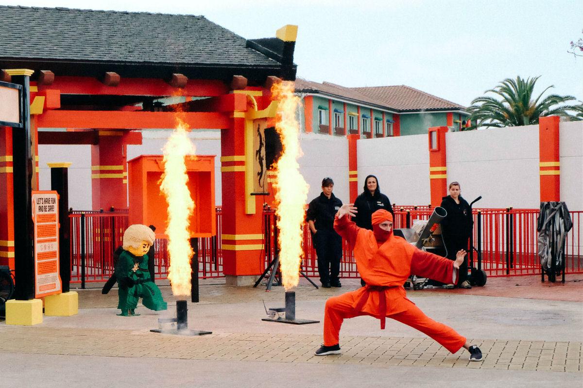 Kai, Master of Fire, showing off his skills at LEGOLAND California's NINJAGO World.