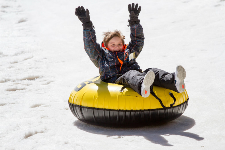Child snow tubing at Taos Ski Valley