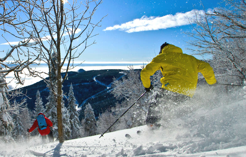 Advanced terrain and skiers at Le Massif de Charlevoix