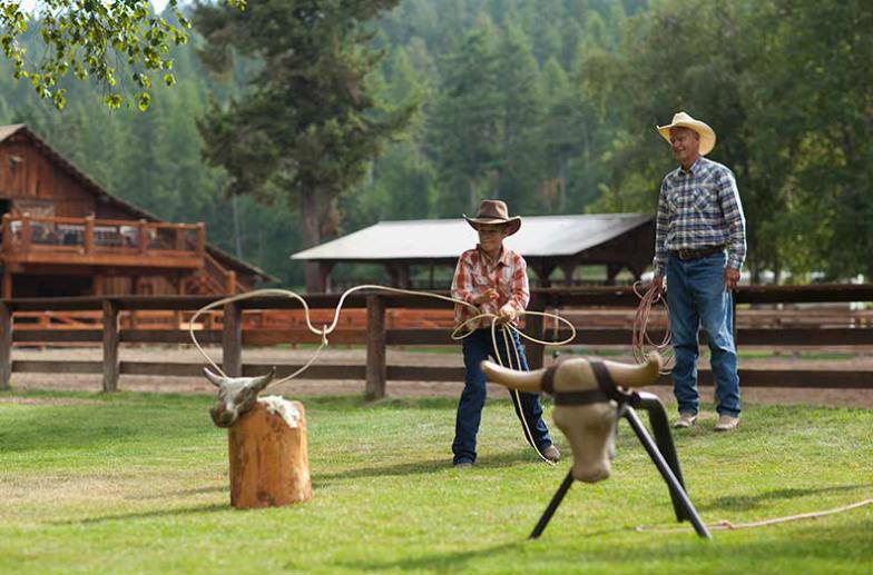Stay at a dude ranch like Flathead Lake Lodge.