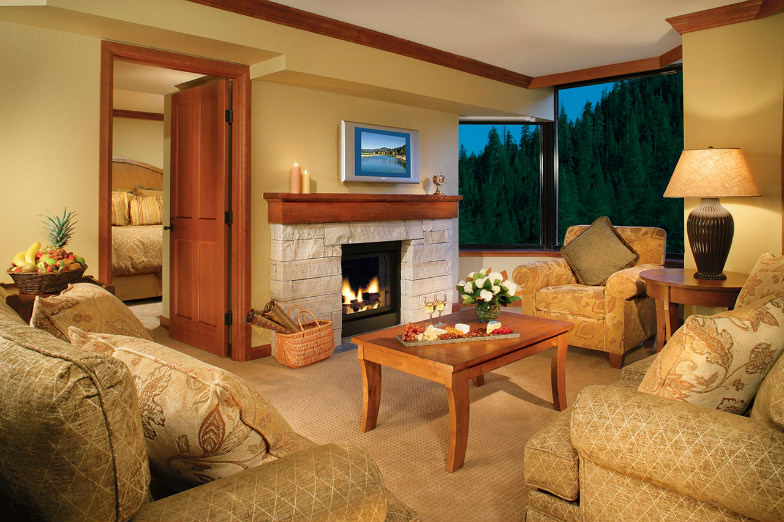 Room with a view and a fireplace at Squaw Creek