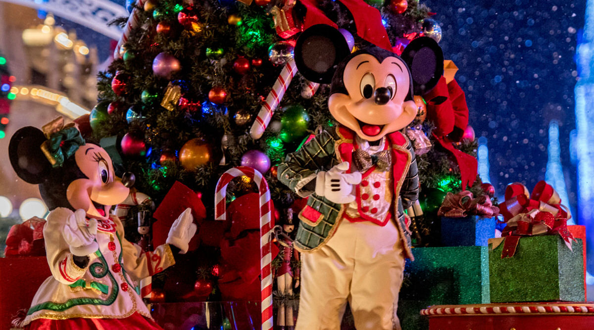 Minnie and Mickey celebrating Christmas at Disney World.