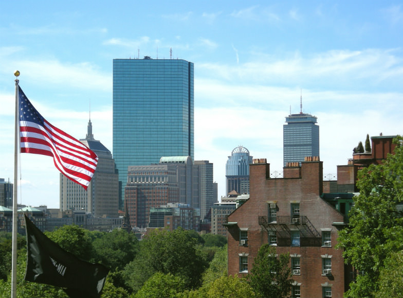 Boston skyline with the American flag