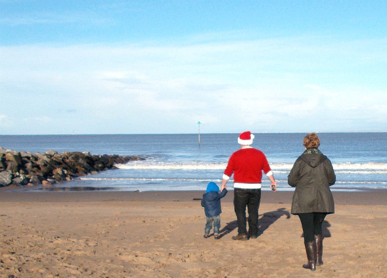 Family on a beach at Christmas