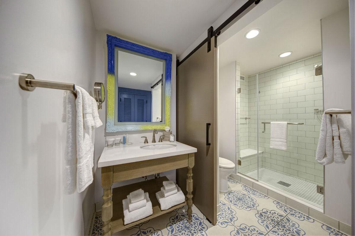 Guest room bathroom at Loews Sapphire Falls